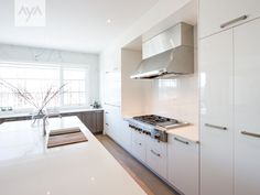 AyA Kitchens | Canadian Kitchen and Bath Cabinetry Manufacturer | Kitchen Design Professionals - Tribeca Stello and Chelsea White High Gloss in Urban Moda