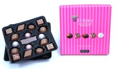 The Ferdia Luxury 32 box contains a sublime selection of handmade chocolates crafted with our own specially blended couverture and the finest natural ingredients, carefully selected by our Chocolatiers.  Contains a mix of: Pasionfruit Ganache, Rustic Praline, Hazelnut & Vanilla Praline, Sea Salted Caramel, Milk Chocolate Placquette, Marc de Champagne Truffle, Lime & Ginger Ganache, Almond & Cardamon, Milk Gianduja Champagne Truffles, Chocolate Crafts, Sea Salt Caramel, Handmade Chocolates, Beautiful Gift Boxes, Almond, Vanilla, Lime, Rustic