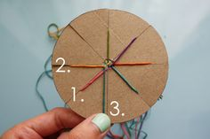 DIY Woven Friendship Bracelet Using a Circular Cardboard Loom. Tutorial from Michael Ann Made.