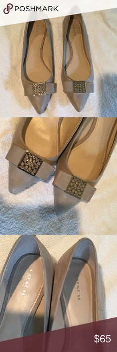 Coach flats Coach taupe/light gray very soft leather flats. See pics for small scuff marks, still beautiful and comfortable. Size 10B barely worn, inside in mint condition Coach Shoes Flats & Loafers