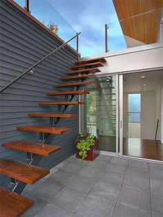 external courtyard stairs leading to the rooftop viewing terrace | modern staircase by Jim Burton Architects