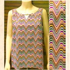Dana Buchman Chevron Sleeveless Top Like new! Wms size M. Stunning sleeveless Dana Buchman blouse with multicolor chevron print, peephole opening at chest with gold colored metal bar, zipper closure in back. Excellent like new condition!⭐️⭐️⭐️⭐️⭐️ It is the BUYER'S responsibility to ensure an item will fit.  ✅ASK QUESTIONS ✅Bundle ✅Offers ❌NO Trades ❌NO Off-Site Transactions Dana Buchman Tops