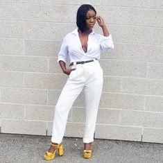 Lolaa wearing white button up shirt and white pants with green leather belt and yellow platform sandals. For more spring outfit ideas check out @_lolaaslooks