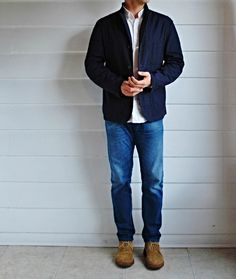 Navy unstructured blazer, Oxford shirt, well-aged denim, and suede chukkas.