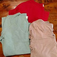 Old Navy top bundle!! Coral light weight sweater Size XS. Light blue light weight, long sleeve sweater Size XS. Light tan top with open sides Size XS. Old Navy Tops