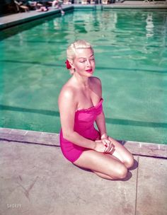 """1951. Santa Barbara, California. """"Lana Turner lounging by the pool at the Coral Casino."""" Color transparency by Earl Theisen for Look magazine."""