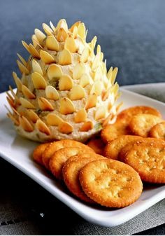 Pinecone Cheese Spread — Cute, right? Pin this recipe for this year's Christmas party: A creamy mix of five cheeses plus Dijon mustard and almond slices.