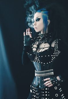 Razor Candi in blue hair and bullet encrusted bodice and skirt