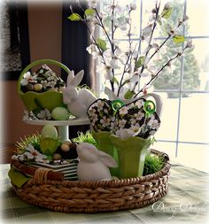 Pretty Easter Vignette in a round basket tray using white, lime and touches of black in the napkins for contrast. ~ Dining Delight: Spring Display in a Tray