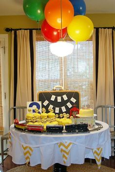 Put a toy train set running (or not) around the cake table