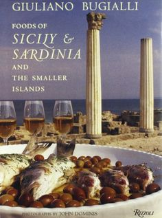 Foods of Sicily & Sardinia and the Smaller Islands by Giuliano Bugialli - The glorious beauty of Sicily and Sardinia and the superb presentation of their foods make this cookbook a delight to read.  Tuna and swordfish reign in the Sicilian kitchen, but there are good recipes for shrimp, too.  Shrimp and potatoes baked with tomatoes fills you up as it nourishes you.  The recipe for whole grilled fish, Sardinian style will teach you how to cook all types of fish to perfection.