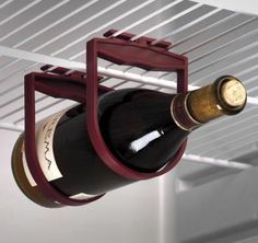 "The Holdups refrigerator wine rack will hold up your wine on the bottom of a shelf to keep it from rolling around, keep the wine bottle horizontal to help preserve it, and free up room for all your other crap you need refrigerated. The holdups wine rack measures 4"" x 5"" x 0.25"", and unfortunately does not include a wine bottle."