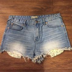 Free People Jean Shorts Size 29 but these run a little small -- I'm listing them at a 28 because these might fit a 28 better! I would definitely not buy if you're on the line of 29/30. Not high waisted. Great quality shorts, they look brand new! Free People Shorts Jean Shorts