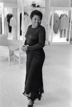 "Actress Esther Rolle trying on a dress in the Joseph Magnin store in Beverly Hills in 1974. She's best known for her roll as Florida Evans on the show ""Good Times"" She attended Spellman College and was a member of the Zeta Phi Beta sorority."