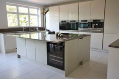 Handleless kitchen island with wine fridge