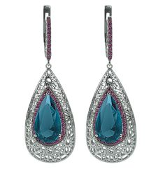 Gold earrings with london blue topaz and violet diamonds // pendientes de oro blanco con topacio azul londres y diamantes violetas www.art-jeweller.com