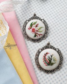 No automatic alt text available. Embroidery Jewelry, Beaded Embroidery, Cross Stitch Embroidery, Embroidery Patterns, Hand Embroidery, Mini Cross Stitch, Handicraft, Needlework, Pendants