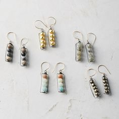 Beads of labradorite, jasper, pyrite, copper, or amazonite form these elegant earrings, each pair hand-crafted by Houston designer Hila. Pairing quality workmanship with an artist's eye for design, Hila Gardner finds inspiration in the ebb and flow of nature, and looks beyond the purpose of functional items to find beauty in the everyday.- Amazonite, jasper, pyrite, copper, or labradorite beads, oxidized sterling silver, 14k gold fill wire- Wipe clean with dry cloth; do not use silver polish…