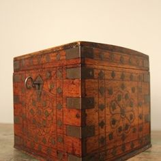 A beautiful little Colonial Anglo-Indian Casket.  Made from solid Padouk , decorated with Brass inlay throughout and brass strap work.