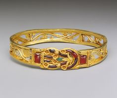 Armband with a Herakles knot, Hellenistic, 3rd–2nd century B.C.  Greek  Gold, garnet, emerald, enamel