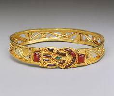 Armband with a Herakles knot, Hellenistic, 3rd–2nd century b.c.  Greek  Gold, garnet, emerald, enamel