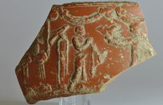Terra sigillata Samian ware shard, 2nd-3rd century A.D. Two figures offering with column with a eagle behind, 10.8 cm long. Private collection