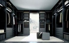 i want a huge walk in closet like this, it would make me feel like if i was a spy!