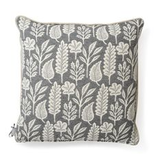 To craft these cushions, first a print is made by hand before then being transferred to a modern weaving machine to translate its complex design. An original Kiran Ravilious' design, a collage of palm leaves adorn the rugs blue fabric, as gentle pale