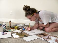 How is this not a picture of me??? The earbuds, the messy bun, the pencil in hand, the scattered papers, back hunched over in a weird position! Oh, the life of an artist.