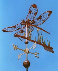 Dragonfly Weather Vane by West Coast Weather Vanes. The Dragonfly weather vane consists of an all copper dragonfly with brass reeds, a copper marsh flower and arrow tip and fletching!Love this Weather Vane! Lightning Rod, Weather Vanes, Dragonfly Art, Yard Art, Windmill, Metal Art, Dragons, Wind Chimes, Metal Working