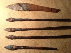 Original prehistoric hafted arrows and original wooden handled flint knife. Knife is from Oregon, arrows are from Arizona. Found preserved in dry caves. Native American Indian artifacts.