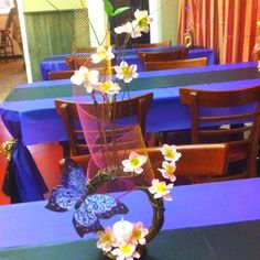CHEAP YET SIMPLE & ELEGANT!  Put a runner in the middle for a lil twist and wont look plain. Make your own centerpiece according to your likings and occasion. Just be creative and explore your imagination. :)