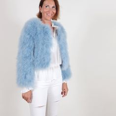 The feather bolero jacket La Fiffi in dust blue from EYES ON MISHA, perfect over party dresses or high-rise trousers, is perfect to get an extravagant, expensive-looking outfit without spending a huge amount. Blue Feather, Bolero Jacket, Fur Fashion, Coral Pink, Army Green, Color Pop, White Jeans, How To Look Better, Fur Coat