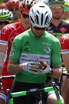 #TDF2016 Mark Cavendish of Great Britain riding for Team Dimension Data works on a Rubik's Cube on the start line prior to stage...