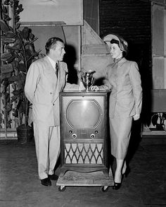 NEW YORK - APRIL 22,1950: Ed Sullivan stands by a television set and June Collyer during rehearsals for 'Toast of the Town' hosted by Ed Sullivan in New York