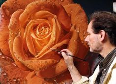 Artist Gioacchino Passini takes an ordinary blank canvas and transforms it into a larger-than-life garden of dewdrop-covered roses.