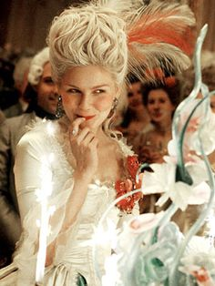 Marie Antoinette 2006 Kirsten Dunst ~ When Marie-Antoinette is going through her shoes while preparing for a big party you see a pair of blue Converse All Star 1923 Chuck Taylor basketball shoes for about one and a half seconds. While these shoes were definitely not in existence at the time of Marie-Antoinette, their inclusion in the film was intentional, to portray Marie-Antoinette as a typical teenage girl despite the time she lived in. (IMDB)