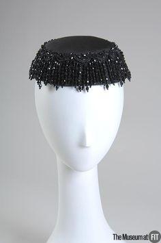 Hat   Cristóbal Balenciaga (Spanish, 1895-1972)   France, circa 1953   Materials: black silk satin with jet beads   The Museum at FIT, New York