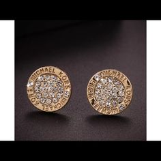 18 karat gold no swag bag still fabulous michael logo around border of earrings with real crystal bling in the center about dime size for men or women