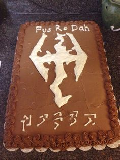 Skyrim Cake-  Decore is melted white chocolate, the name at the bottom is my son's in the skyrim dragon language