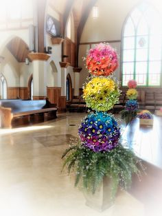 Rainbow Wedding Topiary Floral Arrangements. Designed By Kevin Roberts