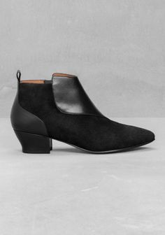 Sleek and slim, these low heel ankle boots have clean, elegant lines and a cool, feminine look.