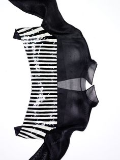 Geoffrey Beene demi-cut over blouse of black gazar and sequined stripes.