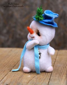 Fabulous handmade characters.  Snegovichok Frosty.  Anna Rybal'chenko.  Arts and crafts fair.  Snowman toy made of wool, felting wool, wool