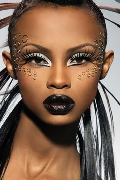 I love the use of these rings on her face...