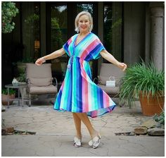Sheree Frede twirling in a mid lenght multi colored stripe dress Fashion For Women Over 40, 50 Fashion, Upf Clothing, Sun Protective Clothing, Nautical Looks, Striped Midi Dress, Swimsuit Cover Ups, Everyday Dresses, Color Stripes