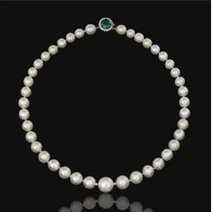 Magnificent and Extremely Rare natural pearl, emerald and diamond necklace Composed of forty-one pearls measuring from approximately 8.5 to 14.7 mm, to a clasp set with a circular-cut emerald within a border of single-cut diamonds