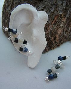 Onyx, Sodalite & Moonstone Ear Cuffs. $20.00, via Etsy.