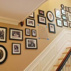 brazilian cherry stairs with collage picture frames