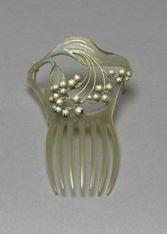 Lily-of-the-Valley hair comb by Rene Lalique | 1900 | Horn, enamel & gold